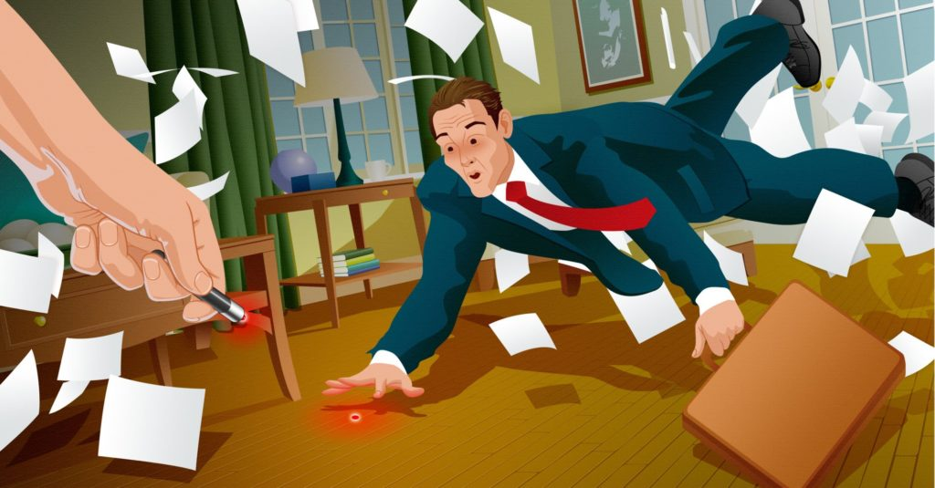 Attorney throws papers while trying to catch a laser (representing a courtroom animation) coming from a laser pointer
