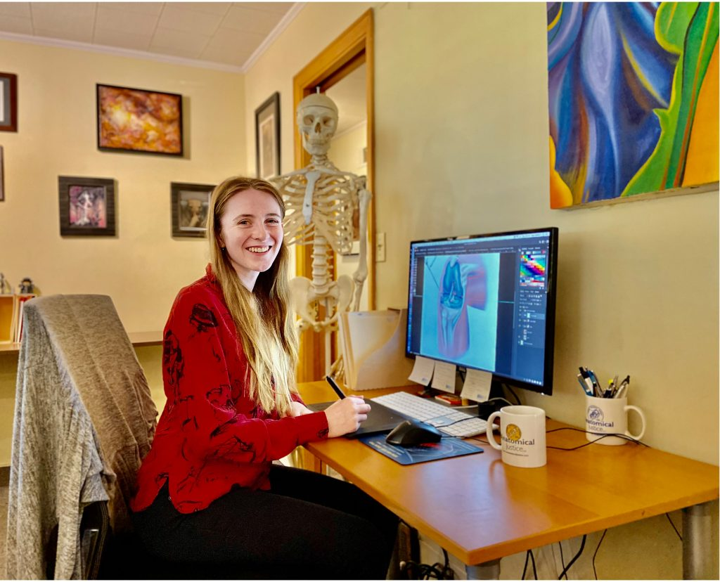 Emily sits in the Anatomical Justice office